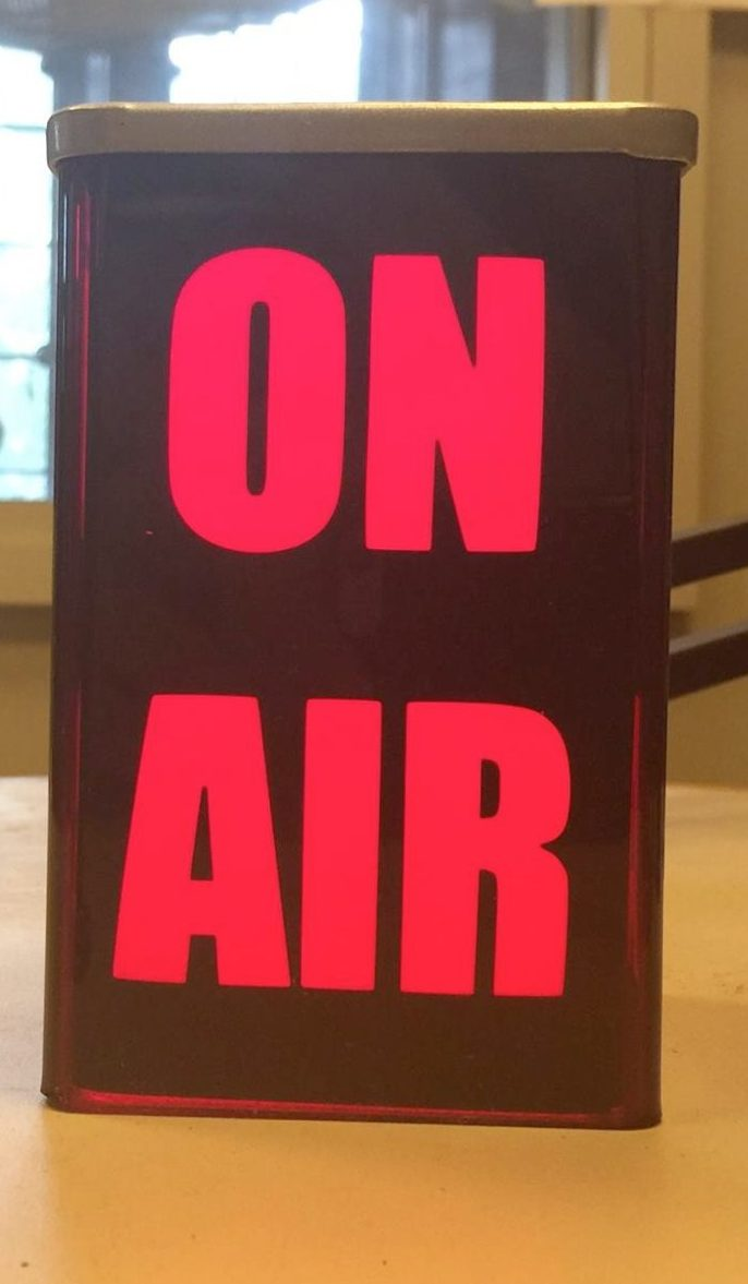 On Air sign, lit up in red.