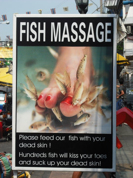 Poster of a woman's foot with small fish nibbling on her feet.