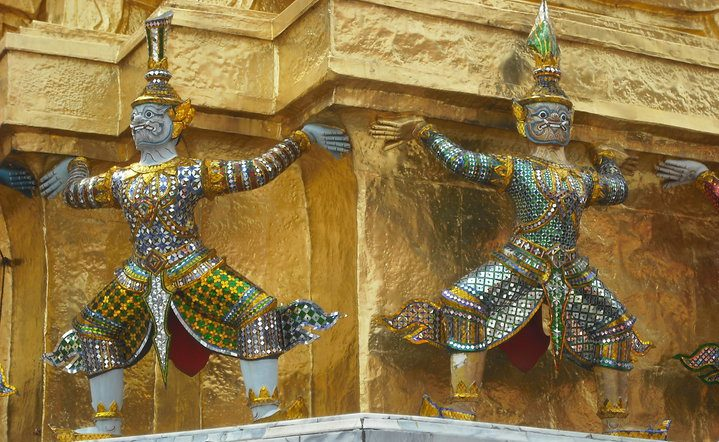 Colourful metal warriors on golden building.